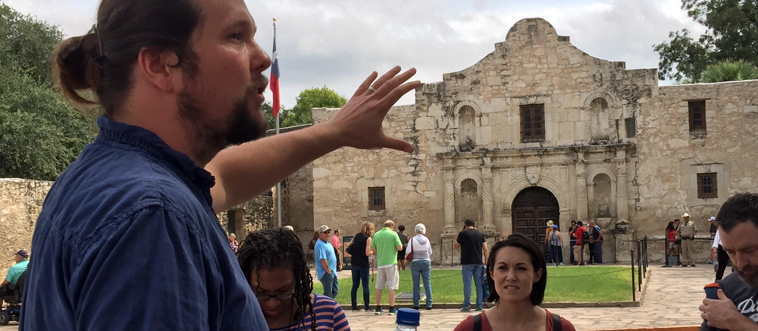 a tour guide talking about the Alamo