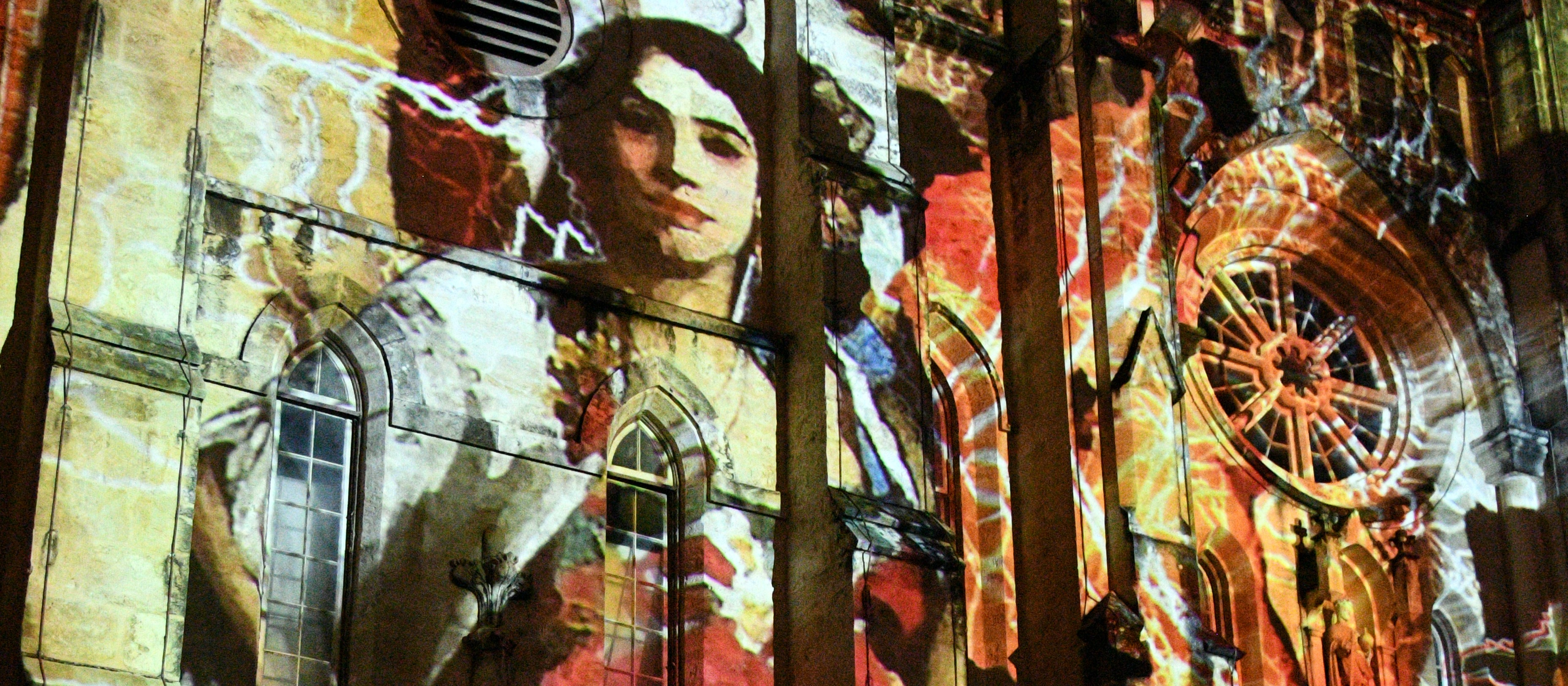 an image of a woman projected onto a church